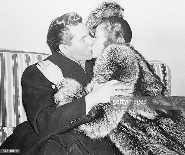 Actress Lucille Ball and Desi Arnaz Cuban glamour boy who eloped to Greenwich Connecticut express their happiness while waiting for Desi to make his...