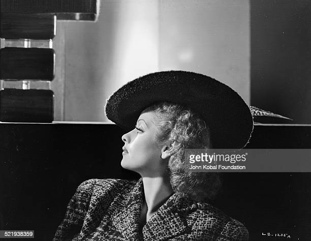 Actress Lucille Ball for RKO Pictures in a promotional shot wearing a wide brimmed hat 1940