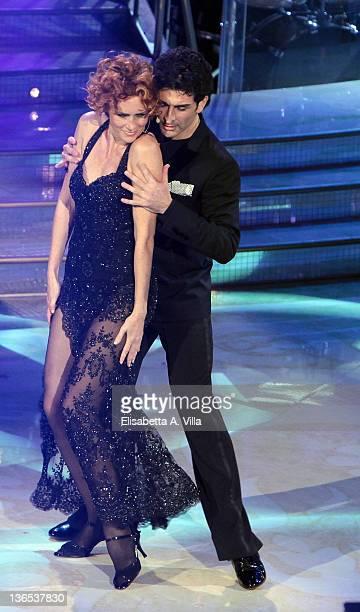 Actress Lucrezia Lante Della Rovere and her dance partner Simone Di Pasquale perform on the Italian TV show 'Ballando Con Le Stelle' at Auditorium...