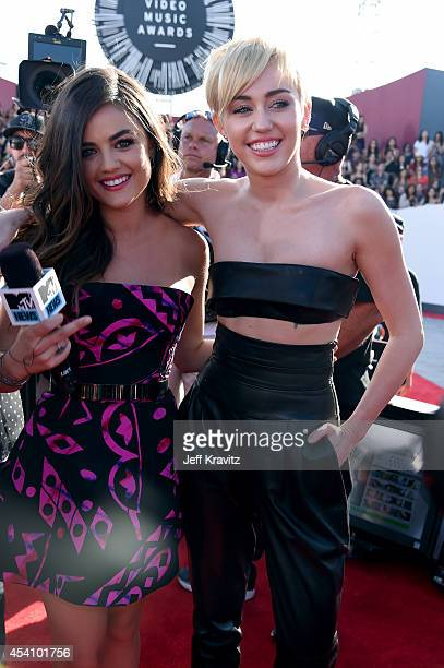 Actress Lucy Hale and recording artist Miley Cyrus attend the 2014 MTV Video Music Awards at The Forum on August 24, 2014 in Inglewood, California.