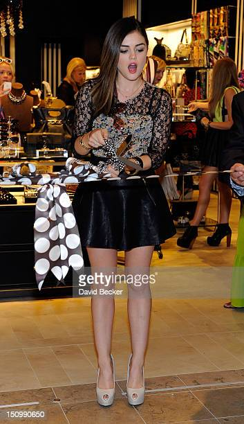 Actress Lucy Hale cuts the ribbon for the grand opening of Henri Bendel at the Fashion Show mall on August 29 2012 in Las Vegas Nevada