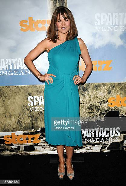 """Actress Lucy Lawless attends the premiere of """"Spartacus: Vengeance"""" at ArcLight Cinemas Cinerama Dome on January 18, 2012 in Hollywood, California."""