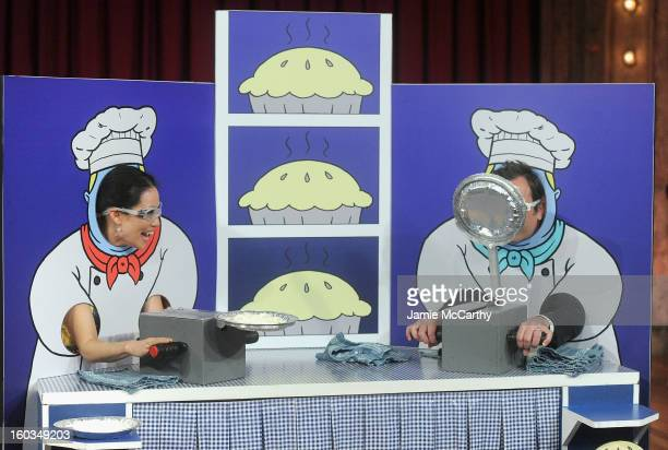 Actress Lucy Liu and host Jimmy Fallon play Rock Paper Scissors and Pie on Late Night With Jimmy Fallon at Rockefeller Center on January 29 2013 in...