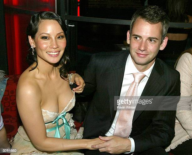Actress Lucy Liu and Zach Helm attend the afterparty for Miramaxs' 'Kill Bill Vol 2' at The Ivar on April 8 2004 in Los Angeles California