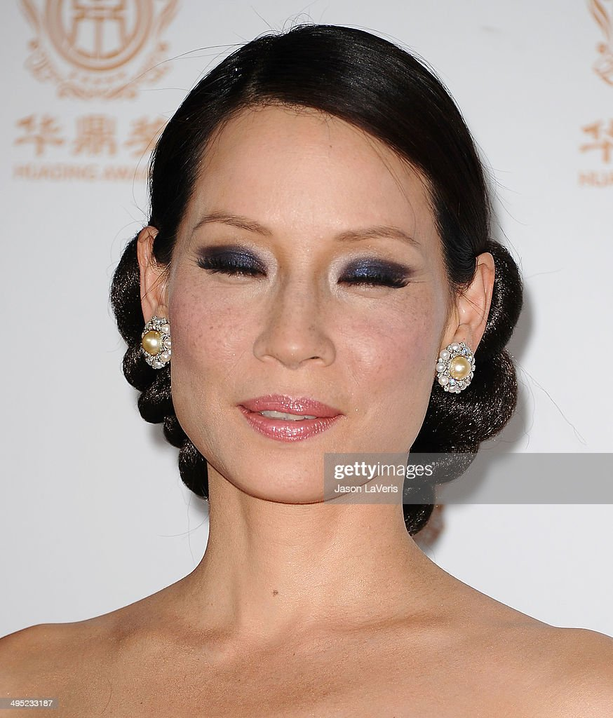 Actress Lucy Liu Poses In The Press Room At The 2014 Huading Film