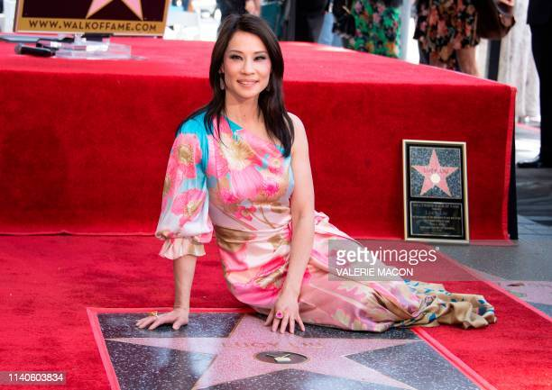 Actress Lucy Liu poses on her newly unveilled star on the Walk of Fame during a ceremony in Hollywood on May 1, 2019. - Lucy Liu's star is the...