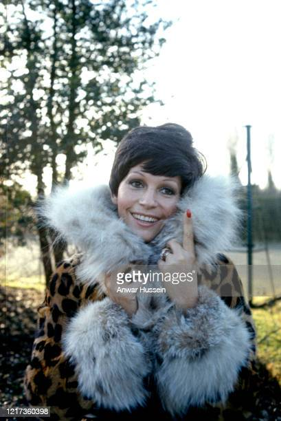 Actress Luisa Mattioli wife of James Bond actor Roger Moore relaxes outside their home In January 1973 in Denham England