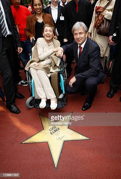 Actress Luise Rainer and Berlin's mayor Klaus Wowereit attend a ceremony honoring her with a Star on the Berlin Walk of Fame on September 5 2011 in...
