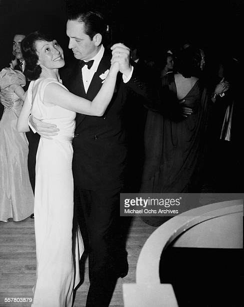 Actress Luise Rainer dances with actor Fredric March during an event in Los Angeles California