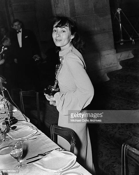 Actress Luise Rainer poses with her Oscar after winning The Academy Award for Best Actress for The Good Earth during the 10th Academy Awards at the...