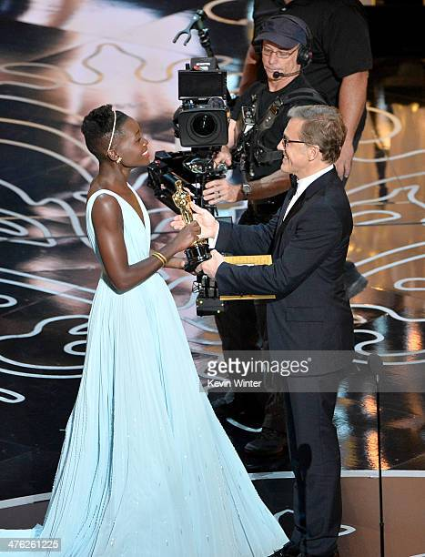 Actress Lupita Nyong'o accepts the Best Performance by an Actress in a Supporting Role award for '12 Years a Slave' from actor Christoph Waltz...