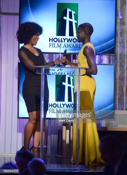 Actress Lupita Nyong'o accepts the New Hollywood Award for '12 Years a Slave' from actress Angela Bassett onstage onstage during the 17th annual...