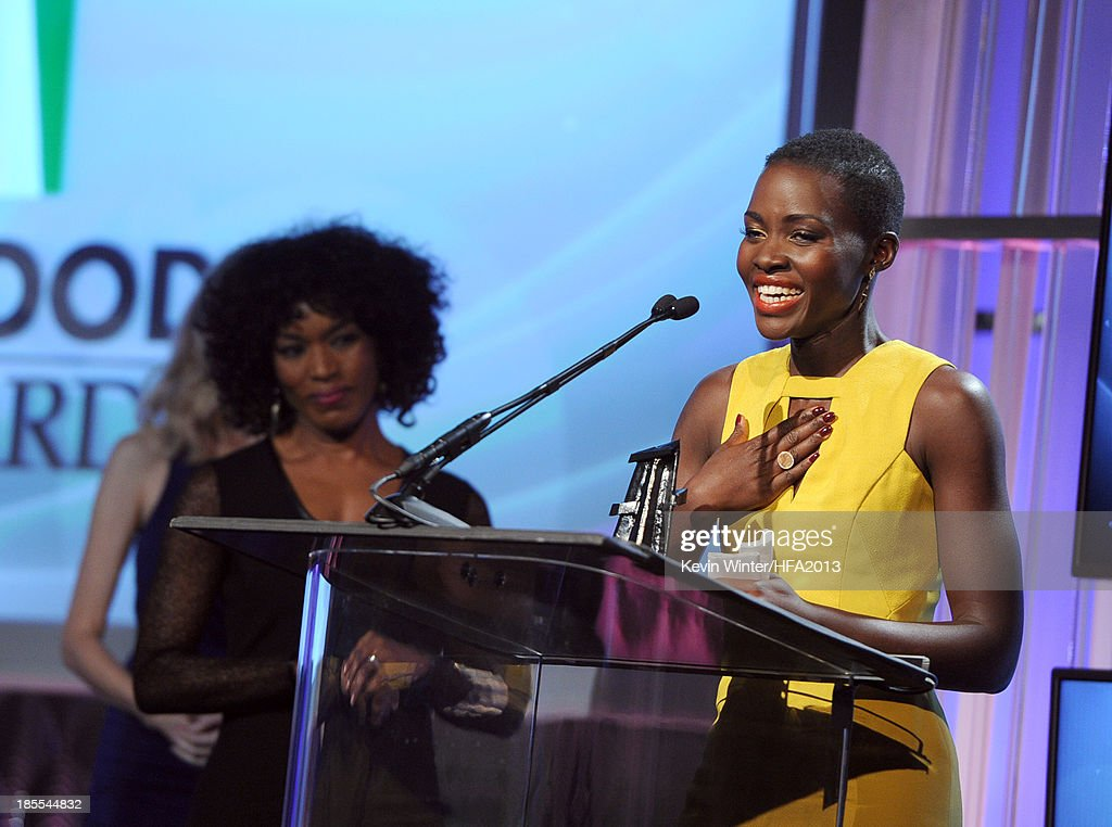 Actress Lupita Nyong'o (R) accepts the New Hollywood Award for '12 Years a Slave' from actress Angela Bassett (L) onstage during the 17th annual Hollywood Film Awards at The Beverly Hilton Hotel on October 21, 2013 in Beverly Hills, California.