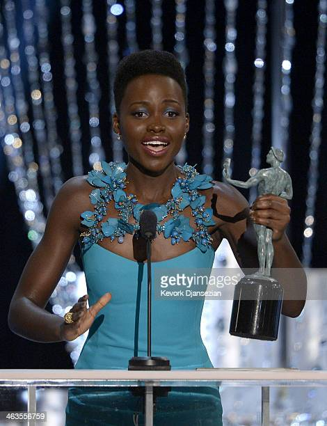 Actress Lupita Nyong'o accepts the Outstanding Performance by a Female Actor in a Supporting Role award for '12 Years a Slave' onstage during the...