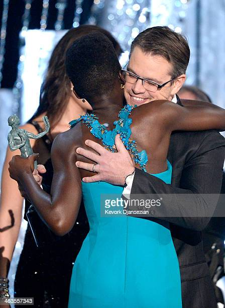 Actress Lupita Nyong'o accepts the Outstanding Performance by a Female Actor in a Supporting Role award for '12 Years a Slave' from actor Matt Damon...