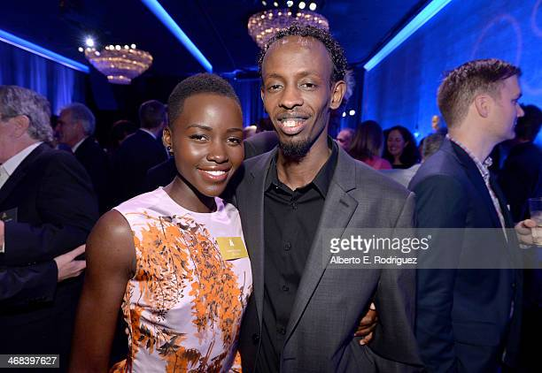 Actress Lupita Nyong'o and actor Barkhad Abdi attend the 86th Academy Awards nominee luncheon at The Beverly Hilton Hotel on February 10 2014 in...