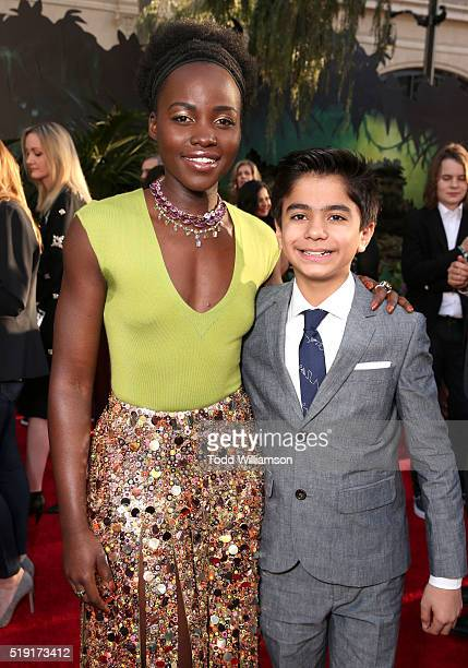 Actress Lupita Nyong'o and actor Neel Sethi attend the premiere of Disney's 'The Jungle Book' at the El Capitan Theatre on April 4 2016 in Hollywood...