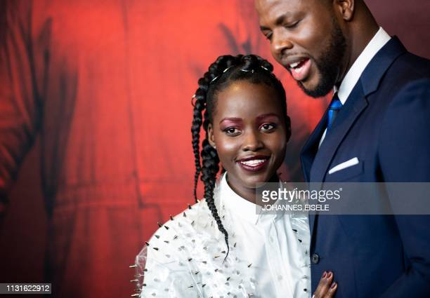 Actress Lupita Nyong'o and actor Winston Duke arrive for the New York premiere of 'US' at the Museum of Modern Art on March 19 2019 in New York City