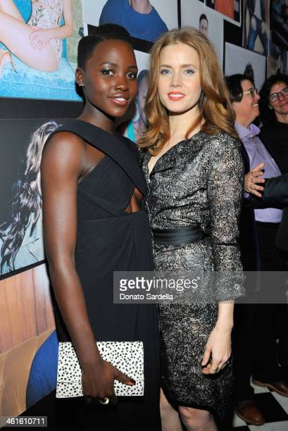 Actress Lupita Nyong'o and actress Amy Adams attend the W Magazine celebration of The Best Performances Portfolio and The Golden Globes with Cadillac...