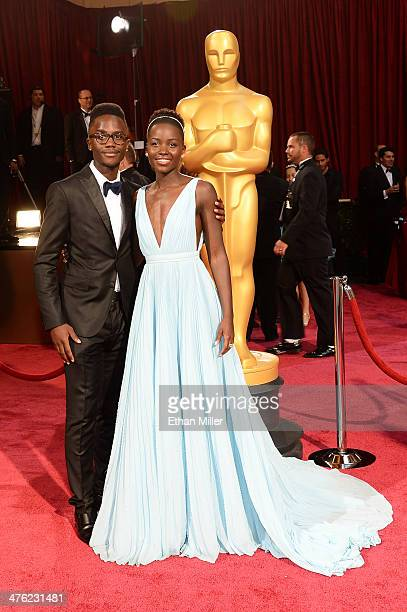 Actress Lupita Nyong'o and brother Peter Nyong'o Jr attend the Oscars held at Hollywood Highland Center on March 2 2014 in Hollywood California