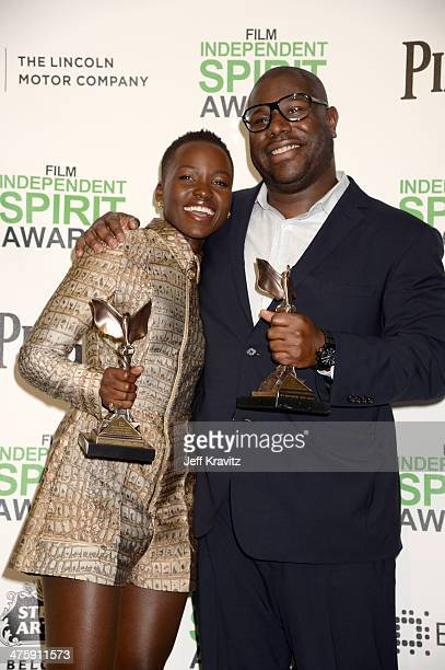Actress Lupita Nyong'o and Director Steve McQueen pose with the award for Best Supporting Female and Best Director for 12 Years a Slave in the press...