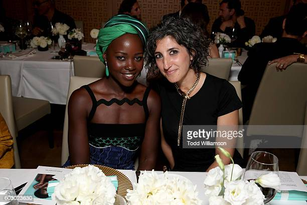 Actress Lupita Nyong'o and Global Creative Director Marketing Tiffany Co Toni Lakis attend the Vanity Fair and Tiffany Co private dinner toasting...