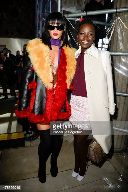 Actress Lupita Nyong'o and singer Rihanna attend the Miu Miu show as part of the Paris Fashion Week Womenswear Fall/Winter 20142015 on March 5 2014...