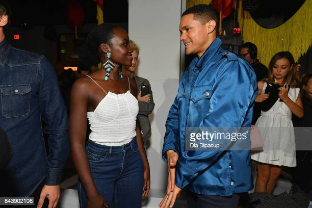 Actress Lupita Nyong'o and TV host Trevor Noah attend the Calvin Klein Collection fashion show during New York Fashion Week on September 7 2017 in...
