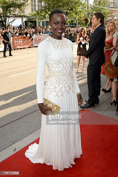 Actress Lupita Nyong'o arrives at the 12 Years A Slave Premiere during the 2013 Toronto International Film Festival Princess of Wales Theatre on...