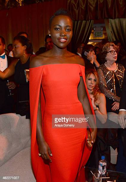Actress Lupita Nyong'o attends The Weinstein Company Netflix's 2014 Golden Globes After Party presented by Bombardier FIJI Water Lexus Laura Mercier...