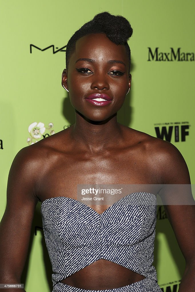 Actress Lupita Nyong'o attends the Women In Film Pre-Oscar Cocktail Party presented by Perrier-Jouet, MAC Cosmetics & MaxMara at Fig & Olive Melrose Place on February 28, 2014 in West Hollywood, California.
