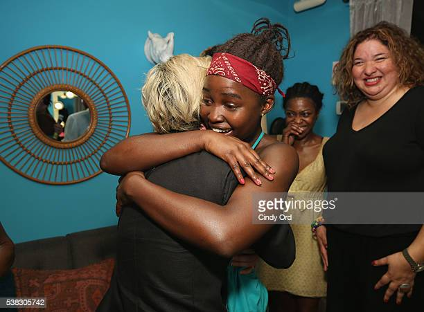 Actress Lupita Nyong'o greets actress Sarah Paulson backstage at Broadway's ÒEclipsedÓ following a special dedication and announcement of a West...