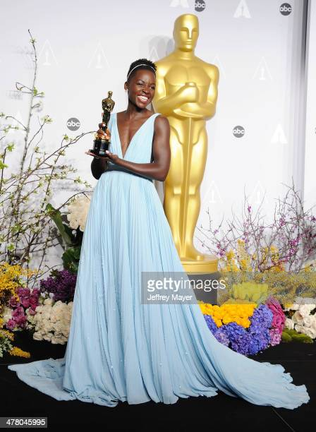Actress Lupita Nyong'o poses in the press room during the 86th Annual Academy Awards at Loews Hollywood Hotel on March 2 2014 in Hollywood California