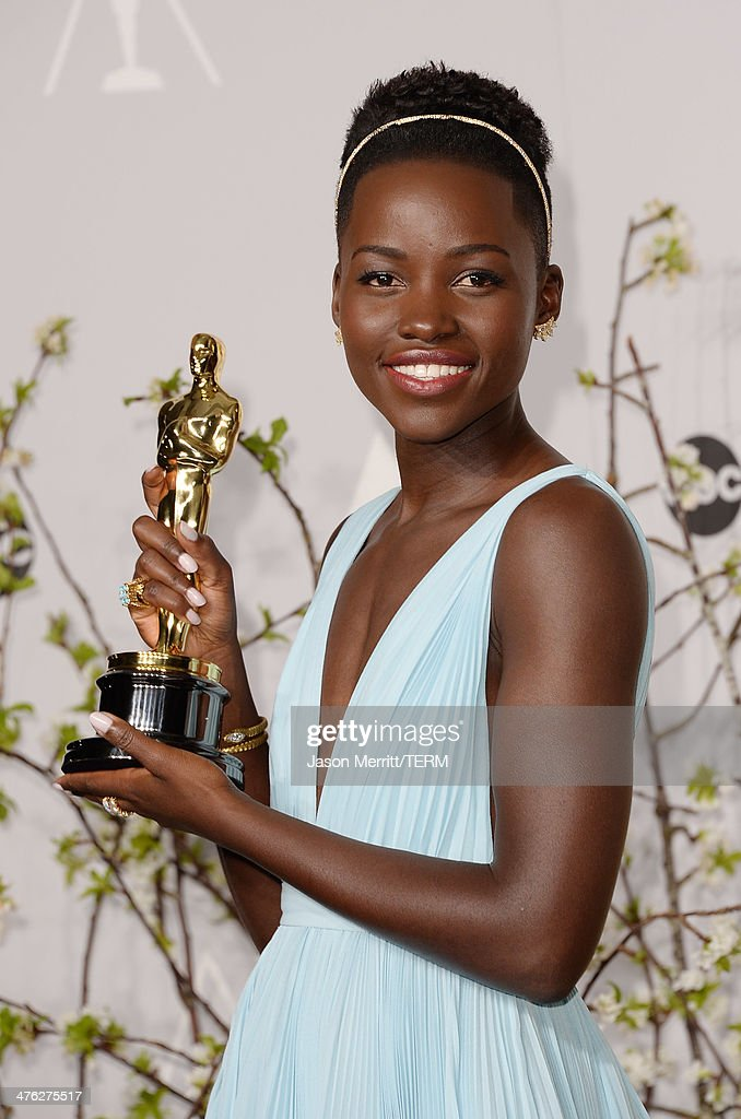 Actress Lupita Nyong'o poses in the press room during the Oscars at Loews Hollywood Hotel on March 2, 2014 in Hollywood, California.