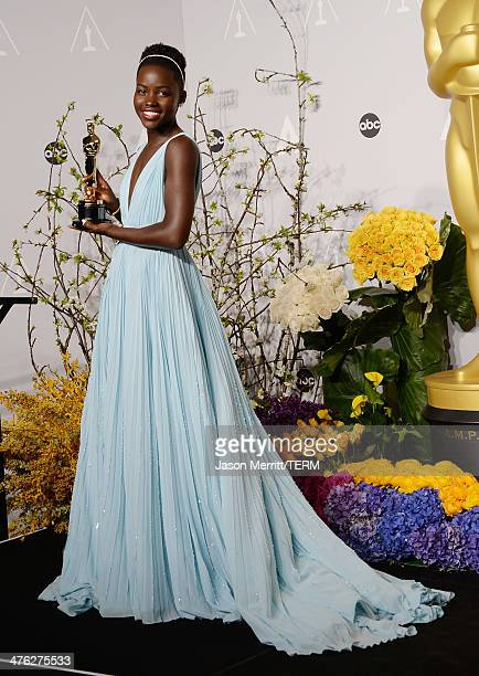 Actress Lupita Nyong'o poses in the press room during the Oscars at Loews Hollywood Hotel on March 2 2014 in Hollywood California