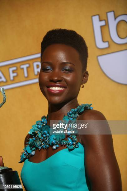 Actress Lupita Nyong'o poses in the press room of the 20th annual Screen Actor's Guild Awards aka SAG Awards at Shrine Auditorim in Los Angeles USA...