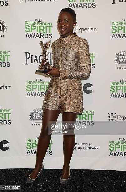 Actress Lupita Nyong'o poses with the award for Best Supporting Female for 12 Years a Slave in the press room during the 2014 Film Independent Spirit...