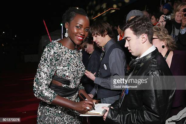Actress Lupita Nyong'o signs autographs at Premiere of Walt Disney Pictures and Lucasfilm's 'Star Wars The Force Awakens' on December 14 2015 in...
