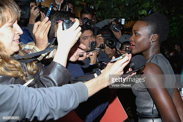 """Actress Lupita Nyong'o speaks with the media during the """"Star Wars: The Force Awakens"""" Mexico City premiere fan event at Cinemex Antara Polanco on..."""
