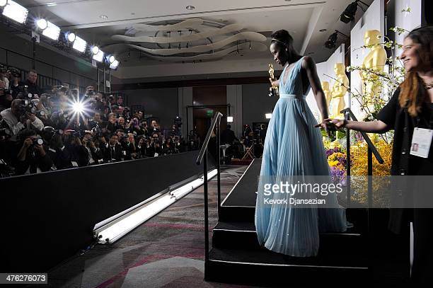 Actress Lupita Nyong'o winner of Best Performance by an Actress in a Supporting Role poses in the press room during the Oscars at Loews Hollywood...