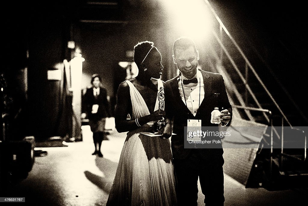 Actress Lupita Nyong'o, winner of Best Performance by an Actress in a Supporting Role backstage during the 86th Annual Academy Awards held at Dolby Theatre on March 2, 2014 in Hollywood, California.