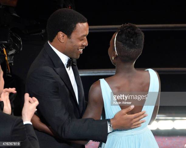 Actress Lupita Nyong'o winner of the Best Performance by an Actress in a Supporting Role award for '12 Years a Slave' with actor Chiwetel Ejiofor...