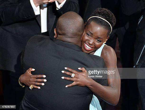 Actress Lupita Nyong'o winner of the Best Performance by an Actress in a Supporting Role award for '12 Years a Slave' with director Steve McQueen...