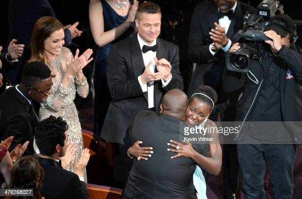 Actress Lupita Nyong'o winner of the Best Performance by an Actress in a Supporting Role award for '12 Years a Slave' with director Steve McQueen as...