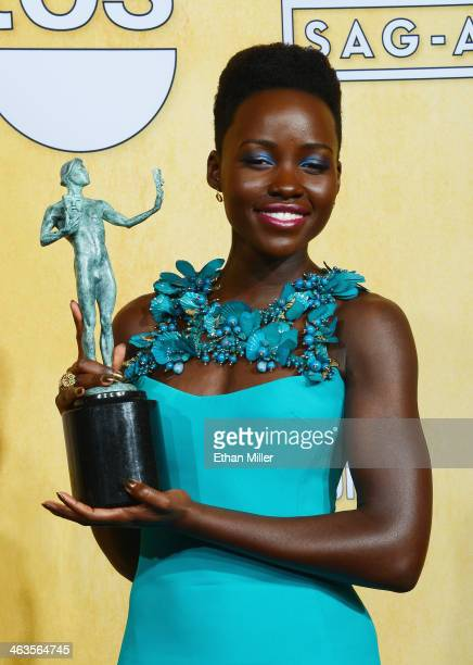 Actress Lupita Nyong'o winner of the Outstanding Performance by a Female Actor in a Supporting Role award for '12 Years a Slave' poses in the press...