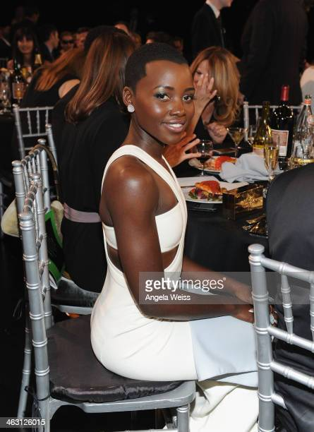 Actress Lupita Nyong'o with Napa Valley Vintners And Sapporo attends the 19th Annual Critics' Choice Movie Awards at Barker Hangar on January 16,...