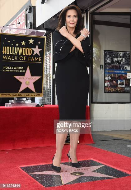 Actress Lynda Carter crosses her wrists in the Wonder Woman pose as she is honored with a star on the Hollywood Walk of Fame, April 3 in Hollywood,...