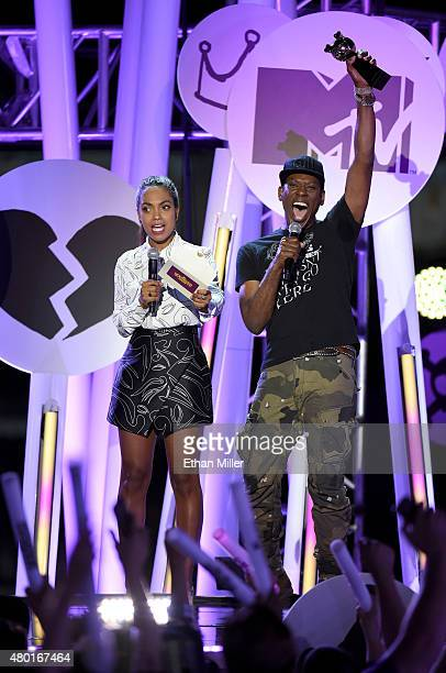 Actress Lyndie Greenwood and actor Orlando Jones present an award during the MTV Fandom Fest San Diego ComicCon at PETCO Park on July 9 2015 in San...