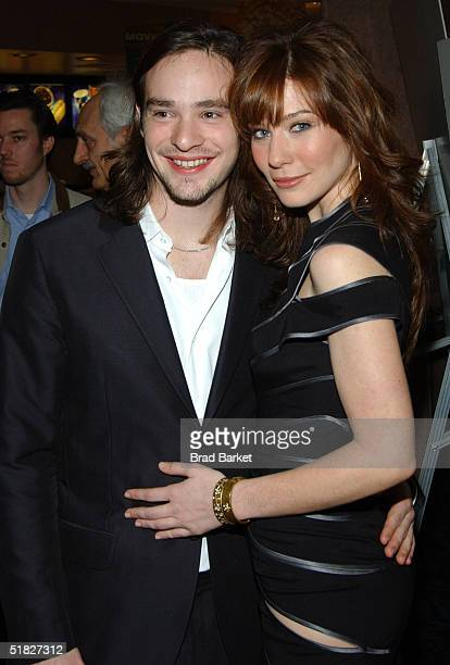 "Actress Lynn Collins and date arrive to the premiere of ""The Merchant of Venice"" at the U/A Theatre on December 5, 2004 in New York City."