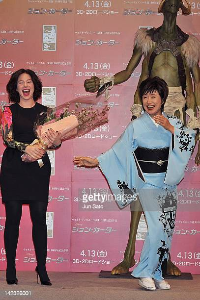 Actress Lynn Collins and singer Sachiko Kobayashi attend the 'John Carter' Press Conference at the Ritz Carlton Tokyo on April 2 2012 in Tokyo Japan...
